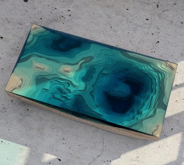 Melyen a dizájner és tervezőcsapata egy évig kísérletezett. Kipróbáltak számos üveget, plexilapot és fa típust, mire végül a megkapták az óceán földrajzi keresztmetszetének 3D-s mását.