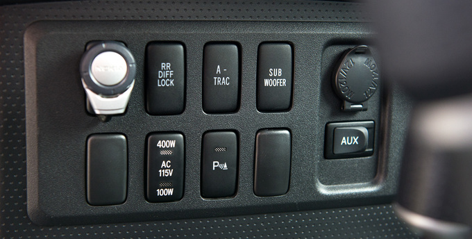 This is what FJ Cruiser is about: traction control and subwoofer switches side by side