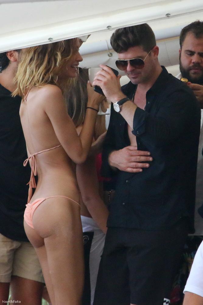 Amíg Robin Thicke rendesen felöltözött, addig a nője bikiniben maradt