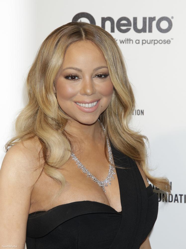 Mariah Carey alaposan felpolcolt mellekkel érezte jól magát Elton John Oscarnéző bulijában.