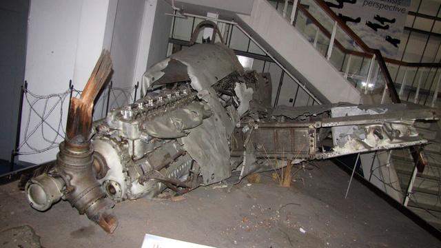 Ez a Hurricane 1940 augusztus 31-én zuhant le, légiharcban sérült meg. A pilóta kiugrott, de nem nyílt ki az ejtőernyője, így meghalt. A roncs 1973-ig érintetlenül nyogodt ott, ahová lezuhant. A darabokat elszállítás után alaposan megtisztították, de nem újítottak fel semmit