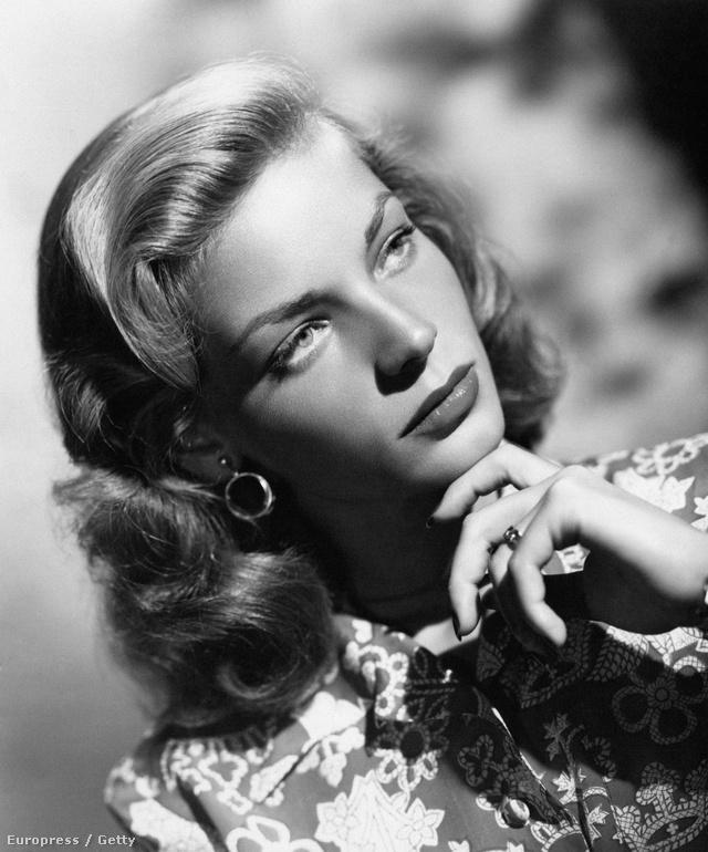 A jellegzetes Bacall nézés. Leszegett fej, felhúzott szemöldök, igéző pillantás. (1940-es évek)