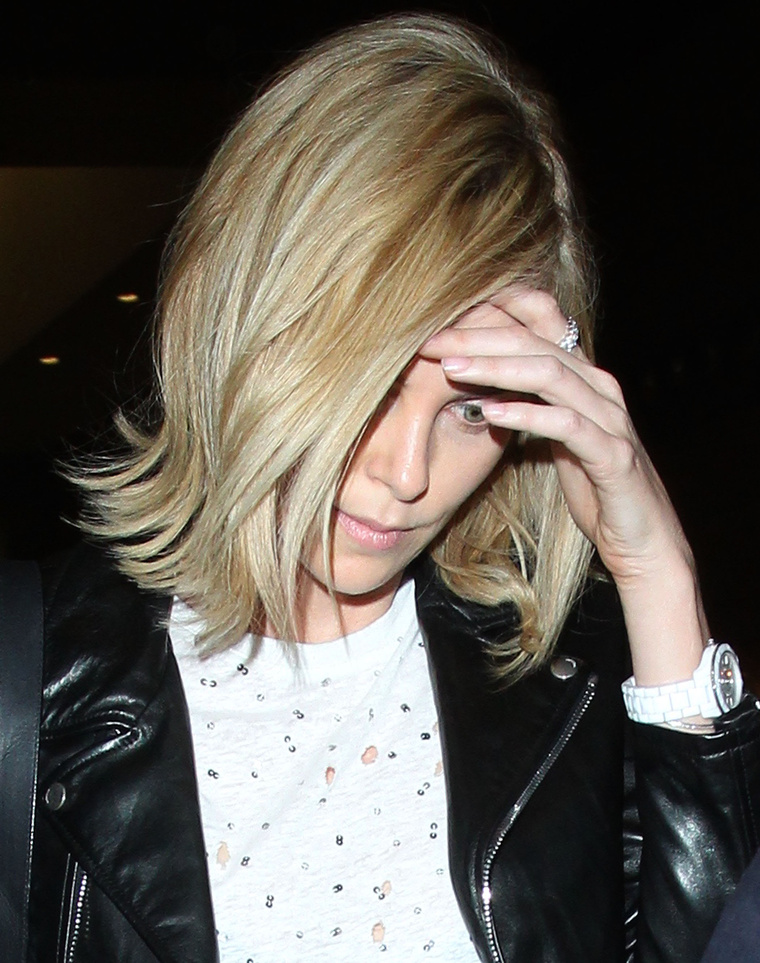 A reptéren így nézett ki a Melbourne-be érkező színésznő.