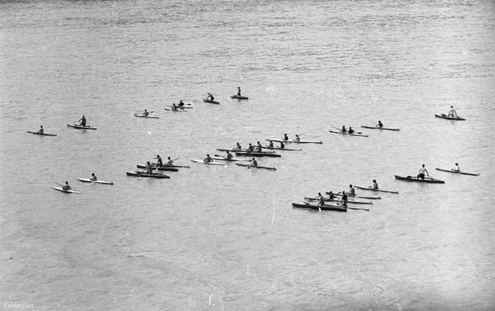 Kajak-kenu. 22 aranyérmet szereztünk az eddigi olimpiai játékokon. Ezzel az eredménnyel Oroszország (és a Szovjetunió) mögött, Svédország előtt a harmadik helyen állunk a kajak-kenu olimpiai éremtáblázatán. A kép az 1960. augusztus 20-i vízi- és légiparádén készült a Széchenyi rakpartról nézve.